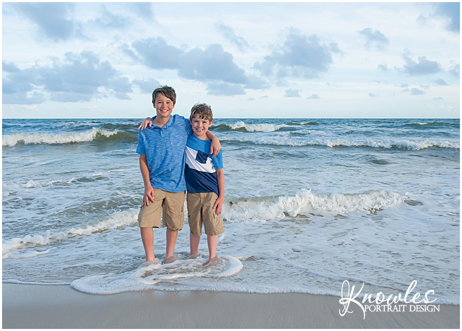 Children at the waves in Pensacola Beach