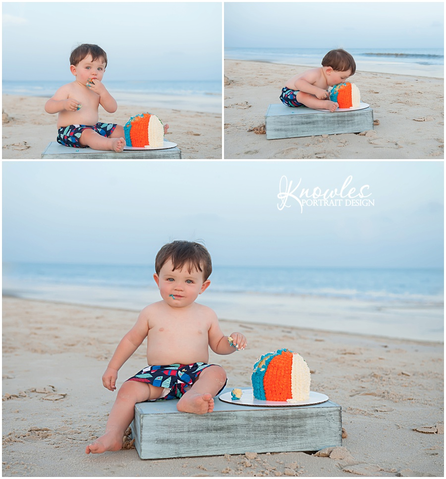 Beach ball baby birthday cake in the sand
